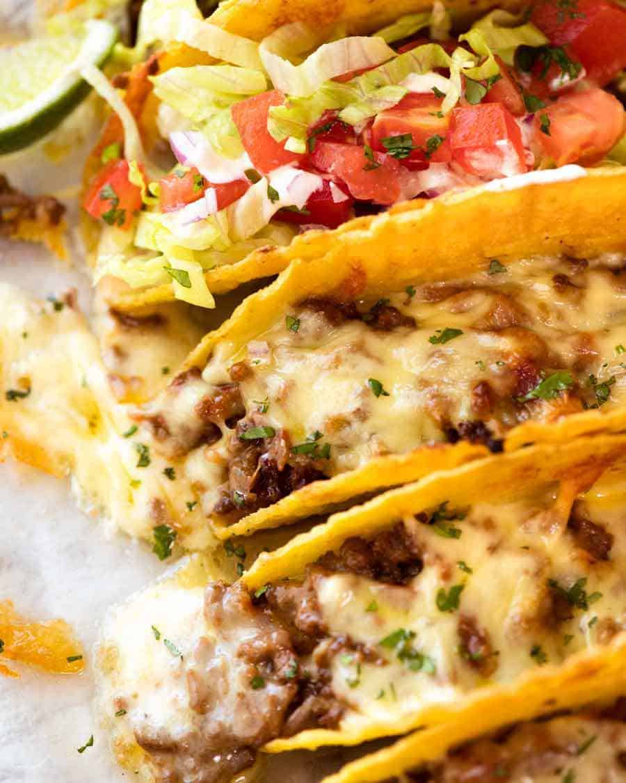 Close up of Beef Taco recipe, fresh out of the oven, with taco meat and melted cheese
