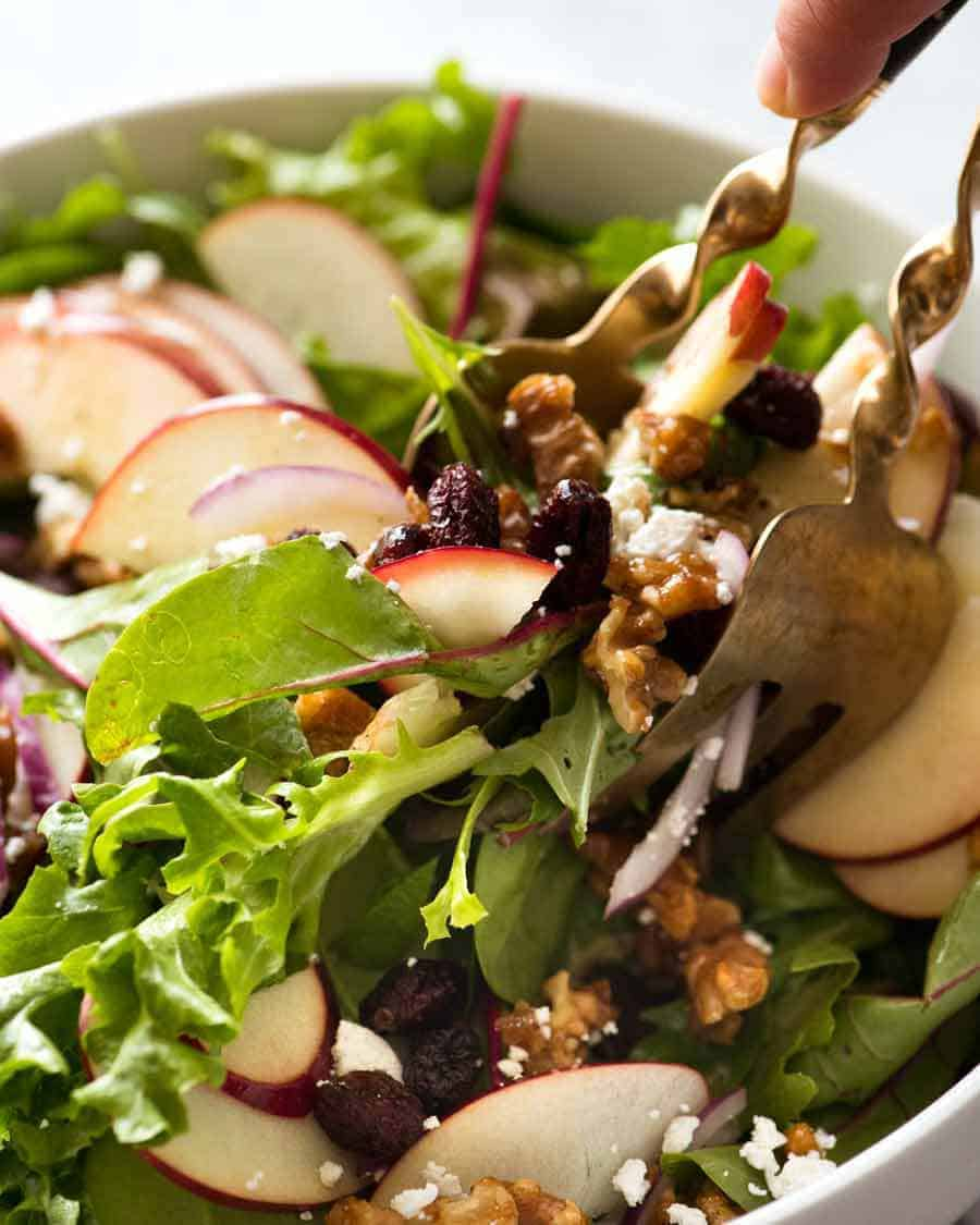 Tossing Apple Salad with Candied Walnuts and Cranberries